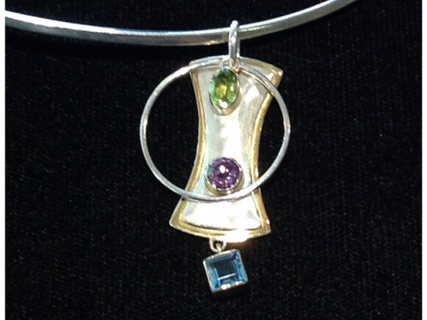 Two Tone Sterling Silver & 22Kt Gold Vermeil Brushed Finished Silver Hour Glass, With Polished Finish Gold Vermeil Frame, With A Bezel Set Amethyst On It, Dangling A Bezel Set Topaz, With A Polished Silver Circle Frame Dangling Behind It, And A Bezel Set Oval Peridot Dangling Across The Top Of It.  Designed and Created By Michou.